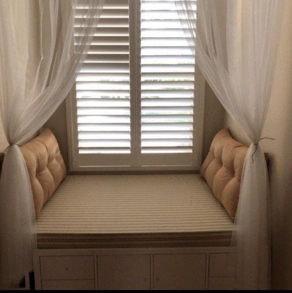 window nook with bench and side cushions