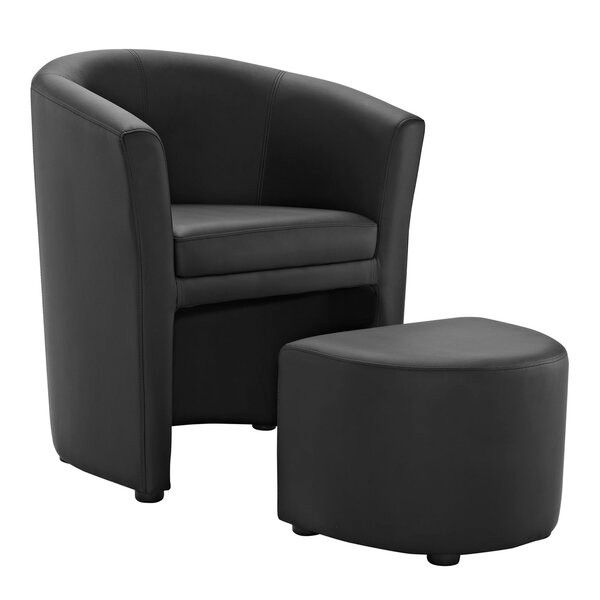 black chair with matching ottoman that slides under the chair