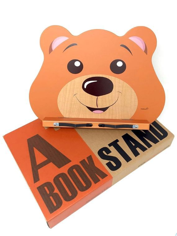 Bear face portable book stand. 'A book stand' is written in all caps. Link: https://i.etsystatic.com/21528433/r/il/af33ad/2295635680/il_794xN.2295635680_b0bc.jpg