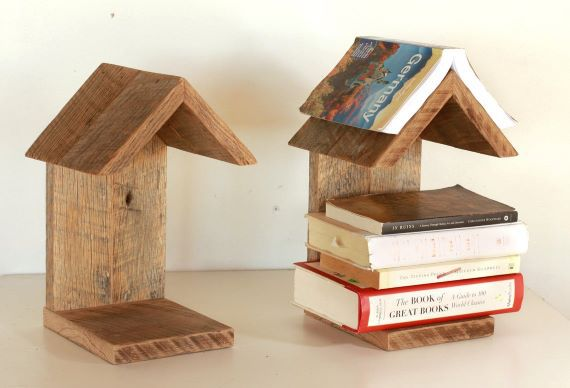 Two wooden portable book stands with trangular shaped tops. The stand on the right holds five books. Link: https://i.etsystatic.com/7540653/r/il/b0bb2e/2115837615/il_1140xN.2115837615_kmli.jpg