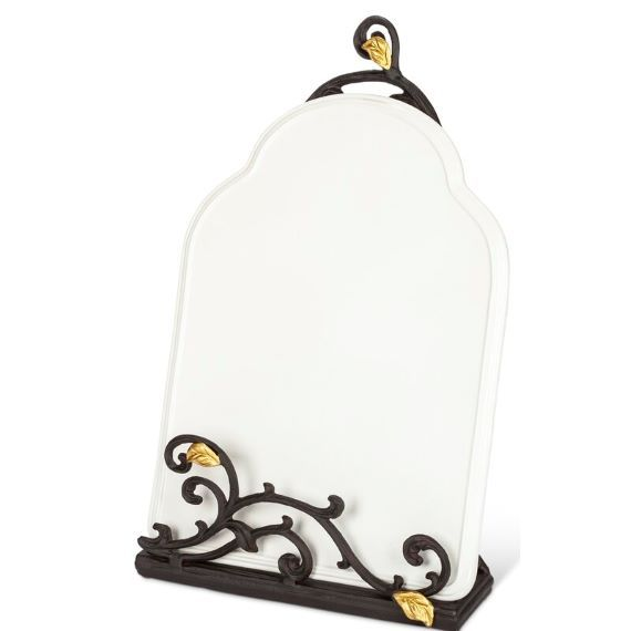 White book holder with a metal vine with gold leaves along the bottom. A vine with leaves is at the top. Link: https://secure.img1-fg.wfcdn.com/im/26019686/resize-h800-w800%5Ecompr-r85/7415/74152307/default_name.jpg