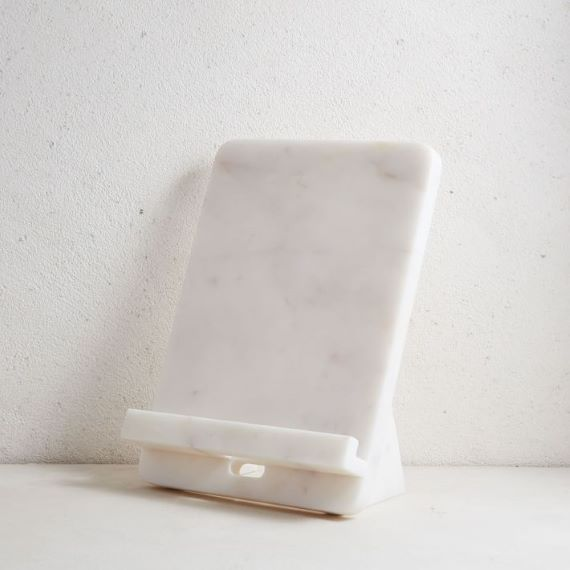 White marble cookbook stand, in front of a white background. Link: https://assets.weimgs.com/weimgs/rk/images/wcm/products/202014/0473/img25o.jpg