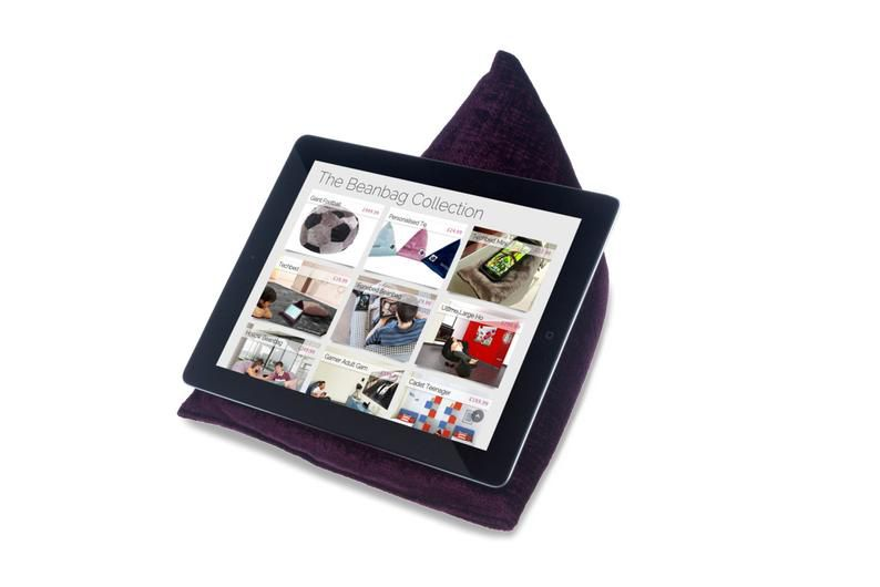 Purple triangular book pillow. An ereader sits on the holder. Link: https://images-na.ssl-images-amazon.com/images/I/81MTh1uk%2BFL._AC_SL1500_.jpg