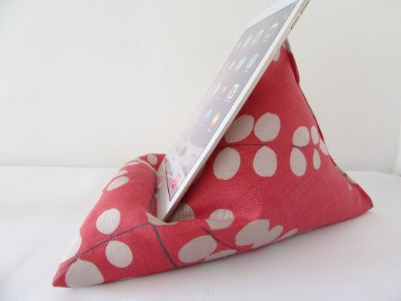 Pink and white book pillow. An iPad rests for support. Link: https://i.etsystatic.com/5660967/r/il/c1c0be/1921781214/il_1140xN.1921781214_6tiu.jpg