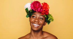 black joy black woman smiling with a flower crown
