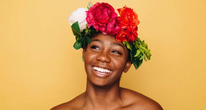 black joy black woman smiling with a flower crown