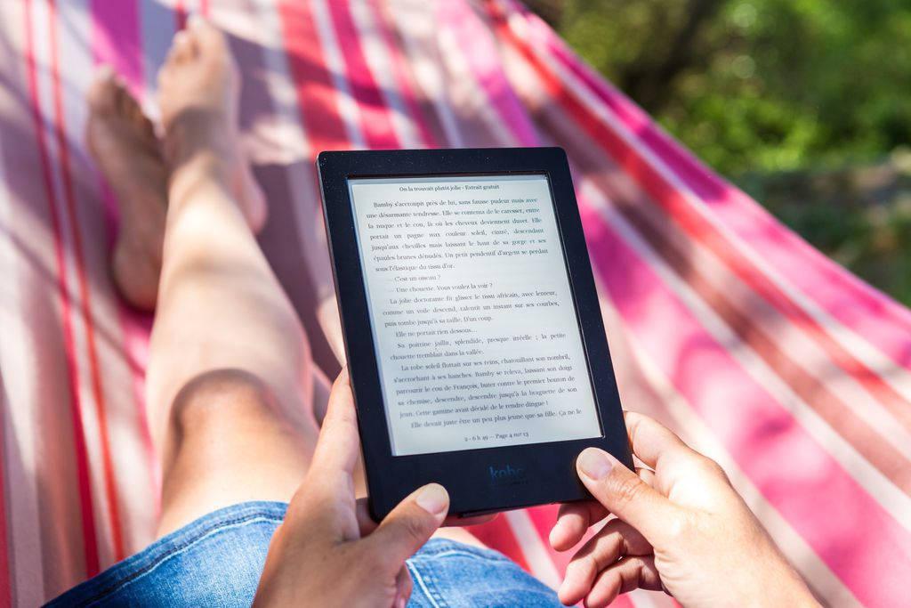 person reading story in Amazon Kindle tablet