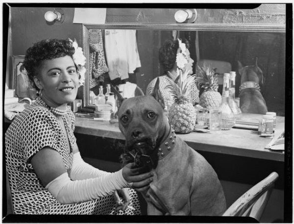 Photo of Billie Holiday and her dog Mister
