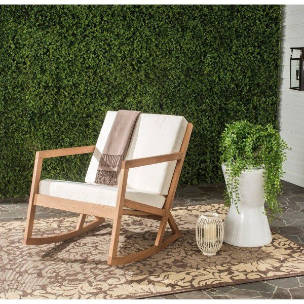 wooden rocker with white cushions