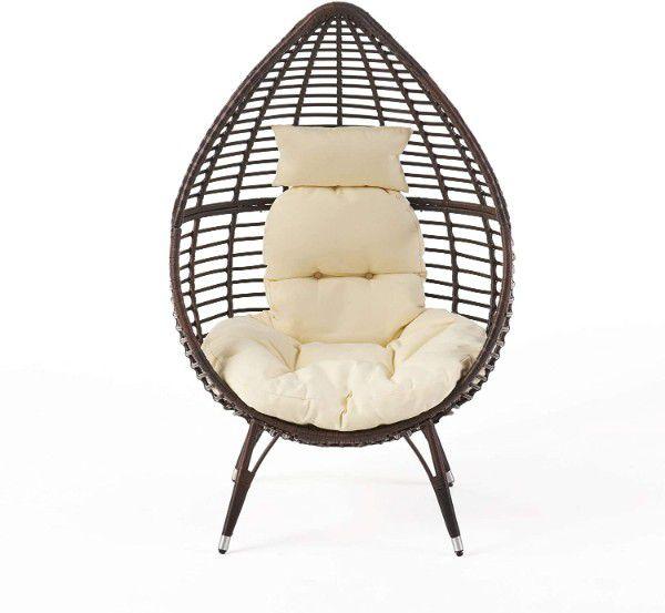 brown teardrop wicker chair with cushions