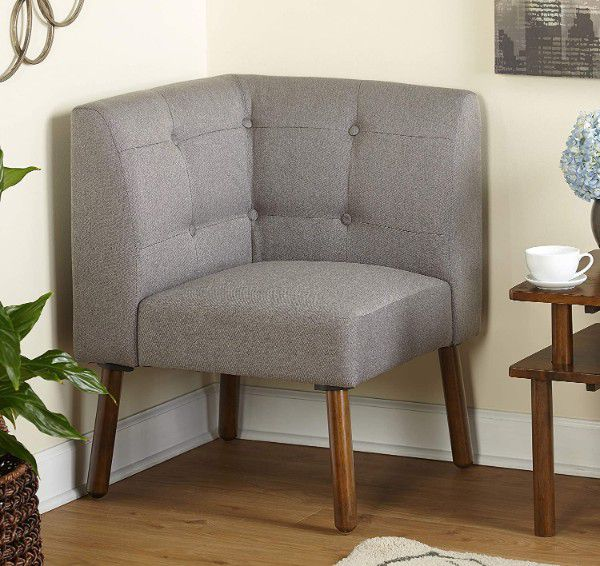 grey corner chair with low back and wood legs