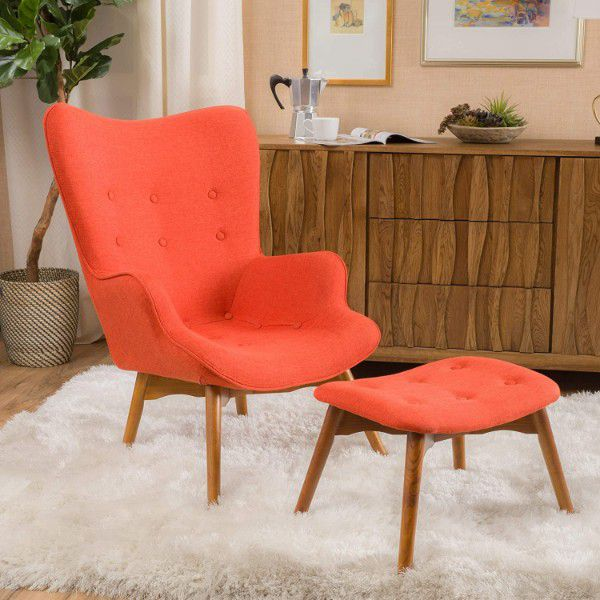 Orange lounge chair with button accents