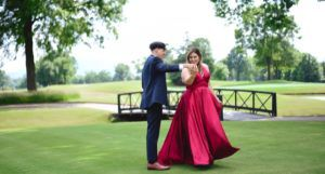 teen couple dancing for prom photo
