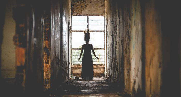 image of woman with hair standing up in an eerie hallway https://unsplash.com/photos/GSrgTVqS0dk