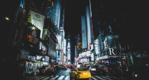 image of Times Square in New York City at night https://unsplash.com/photos/fLxWR2dS76I