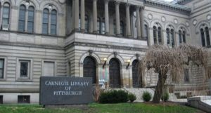 image of the Carnegie Library of Pittsburgh https://en.wikipedia.org/wiki/Carnegie_Library_of_Pittsburgh#/media/File:CarnegieLibraryPittsburghFrontEntrance.jpg