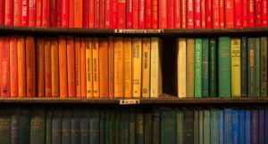 image of bookshelf organized by color https://unsplash.com/photos/D4YrzSwyIEc