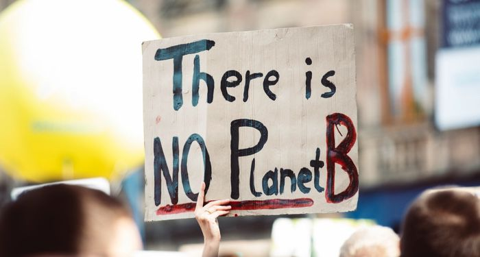 "image os a sign reading ""there is no planet B"" at a climate change rally"
