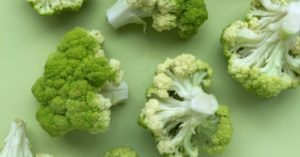 cauliflower heads against a green background