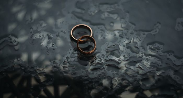 wedding rings on wet surface
