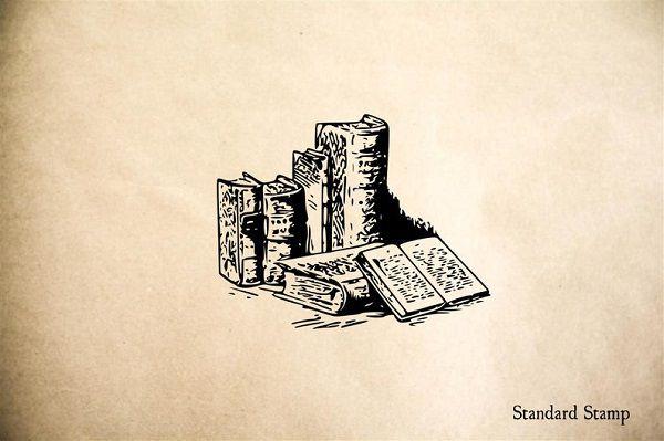 Books on Desk by StandardStamp.jpg.optimal