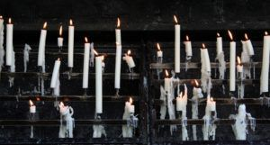 a host of candles burning