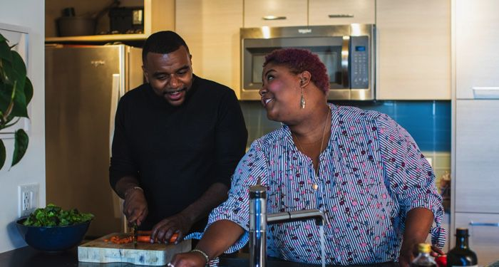 image of a Black man and plus size Black woman cooking in kitchen https://unsplash.com/photos/ce5ShWF9tAY