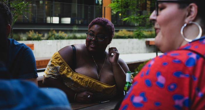 Black plus size woman in summer outfit https://unsplash.com/photos/ZSMwf9UKhG0
