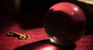 image of a crystal ball and a skeleton key on a red surface https://unsplash.com/photos/X0UrDOiHaS0