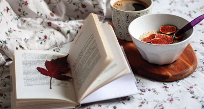 open book with fall leaf bookmark coffee and breakfast