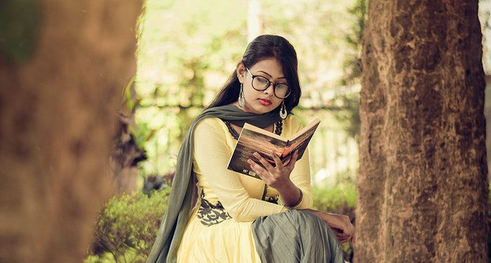 History of Reading. A woman dressed in a yellow and gray sari, reading a book. Photo by Joy Deb from Pexels Link: https://www.pexels.com/photo/woman-reading-book-1580272/?utm_content=attributionCopyText&utm_medium=referral&utm_source=pexels