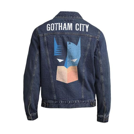 Back of a denim jacket. At the shoulders, it says Gotham City. The back has an image of Batman's face in Blue