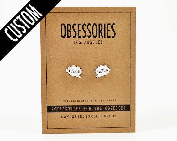 """Speech bubble earrings with the word """"custom"""" inside"""