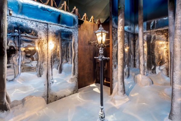 Mirrors, trees and a streetlamp in an indoor winter scene