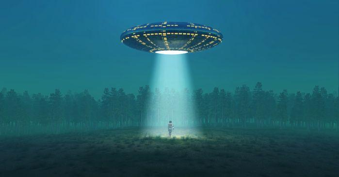 UFO abducting someone in a dark field