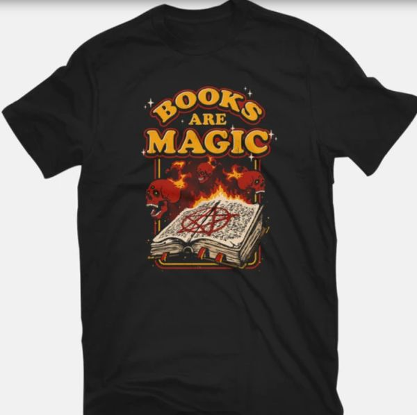 Books Are Magic T-shirt - TeeFury - image of open book of spells surrounded by flying, flaming skulls with text arced above
