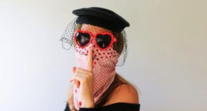 image of woman disguised by heart-shaped sunglasses, a black veil, and a bandana over her face https://unsplash.com/photos/3ohyK-zdPiM