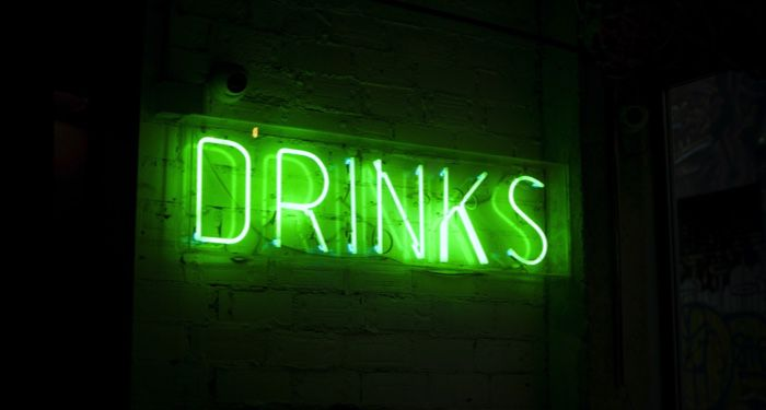 """image of a neon green sign that reads """"Drinks: https://unsplash.com/photos/LbUzPqxPUAs"""