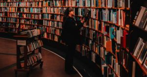 woman browsing books in a library