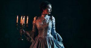 victorian woman holding candelabra