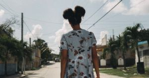 young black girl walking down the street