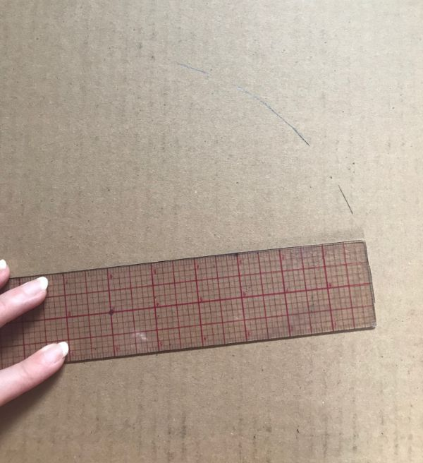Drawing dashes on cardboard with a ruler