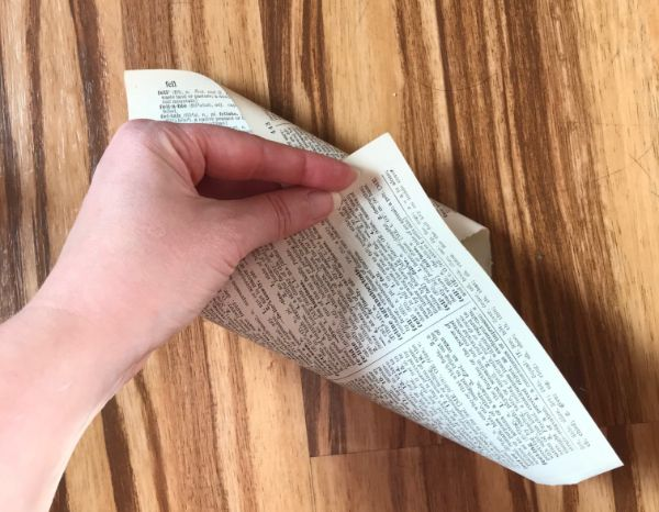 Picture of a dictionary page being rolled into a cone