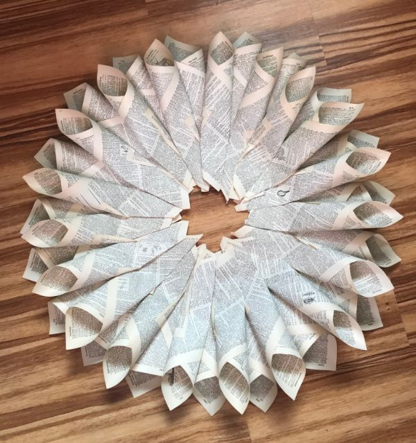 A picture of a book page wreath with two layers and untrimmed edges