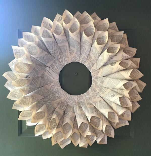 A book page wreath hanging on a door