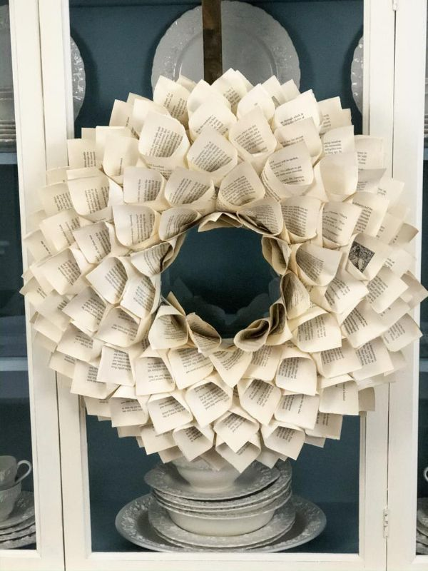 Picture of vintage book page wreath against china cabinet