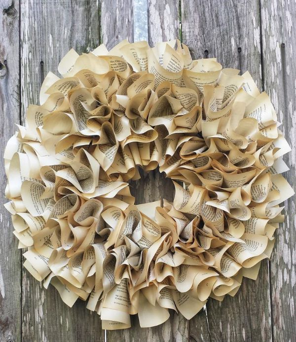 Picture of scrunched paper wreath against wood planks