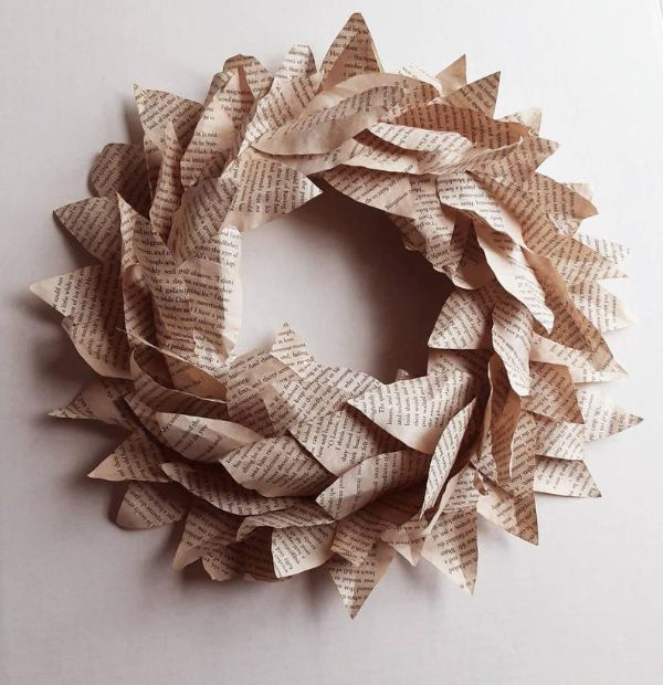Picture of wreath made from book pages cut in the shape of magnolia leaves