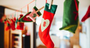 image of Christmas stockings handing on a line https://unsplash.com/photos/coXB9EFuWWg