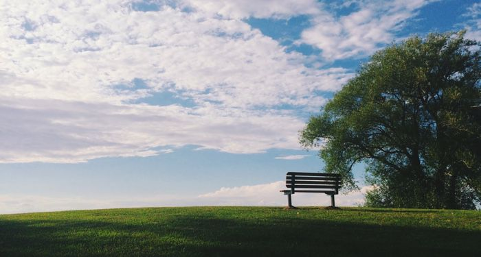 image of an empty bench on a hillside against a blue sky https://unsplash.com/photos/EBB45rCSjrU